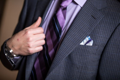 Suit with purple shirt